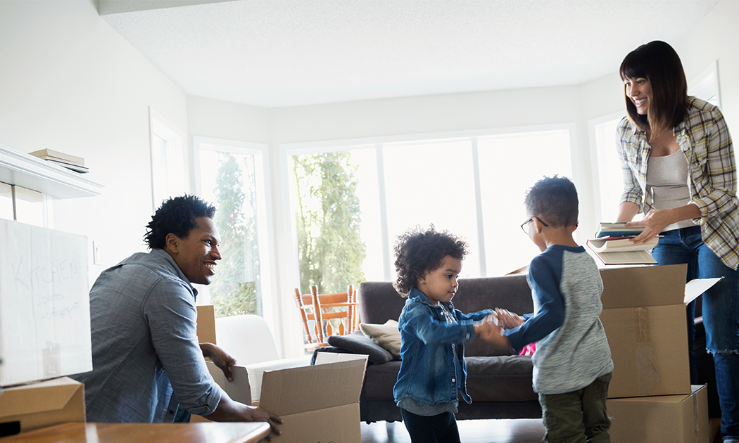 Young Family Moving Into Their Home